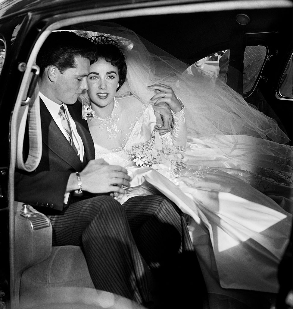 Elizabeth Taylor and hotel heir Conrad 'Nicky' Hilton sit in a limousine on their wedding day  | Getty Images