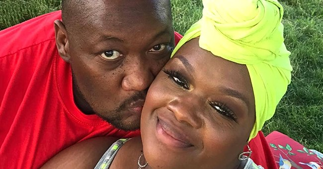 Troy Green kissing his wife Charletta Green on the cheek while she smiles.   Source: gofundme.com