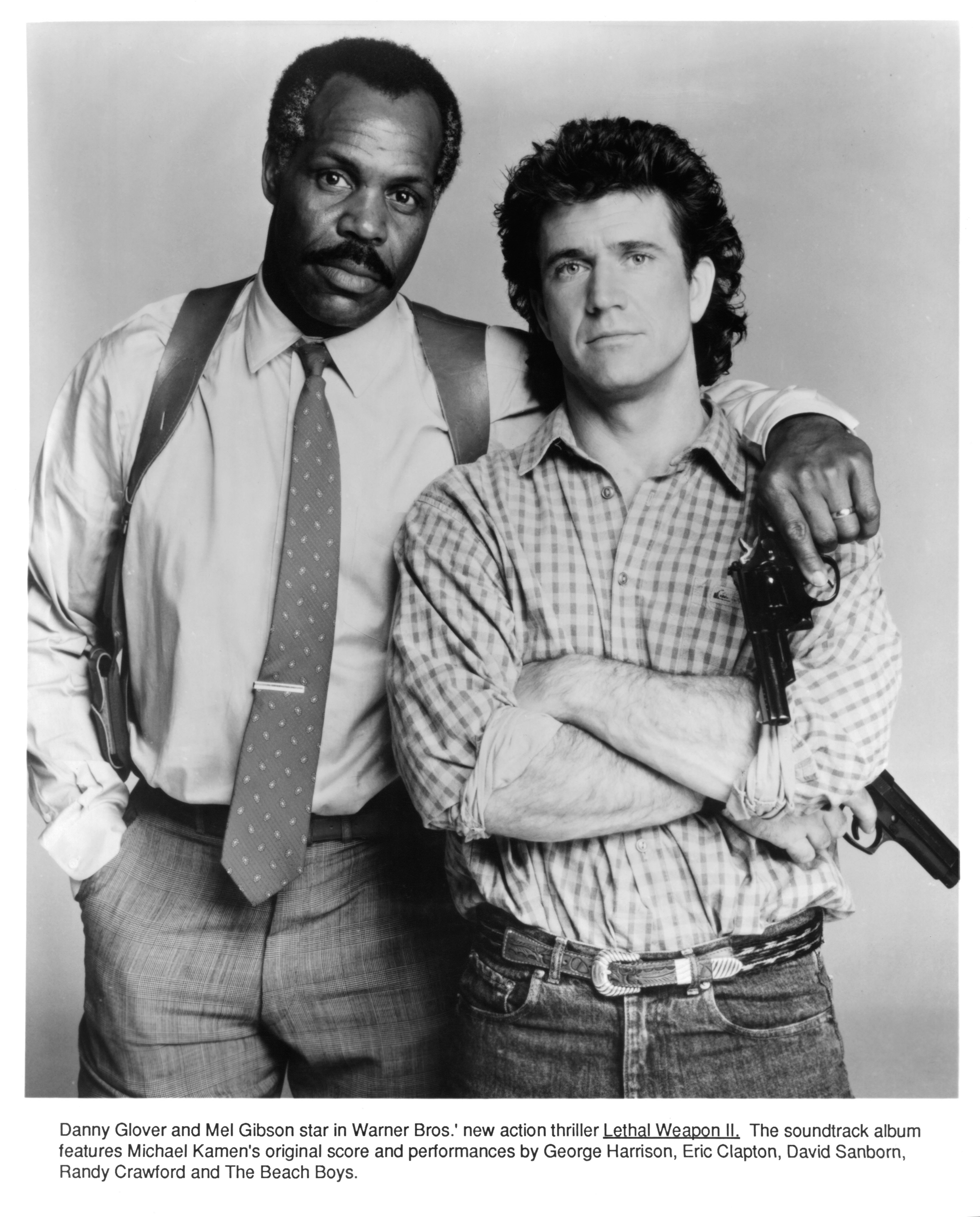 """Danny Glover and Mel Gibson shoot a publicity portrait for 1987's """"Lethal Weapon"""" 