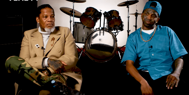 Dee Jay Daniels and DL Hughley during their interview with Vlad TV, posted on YouTube in February 2021 | Photo: YouTube/djvlad