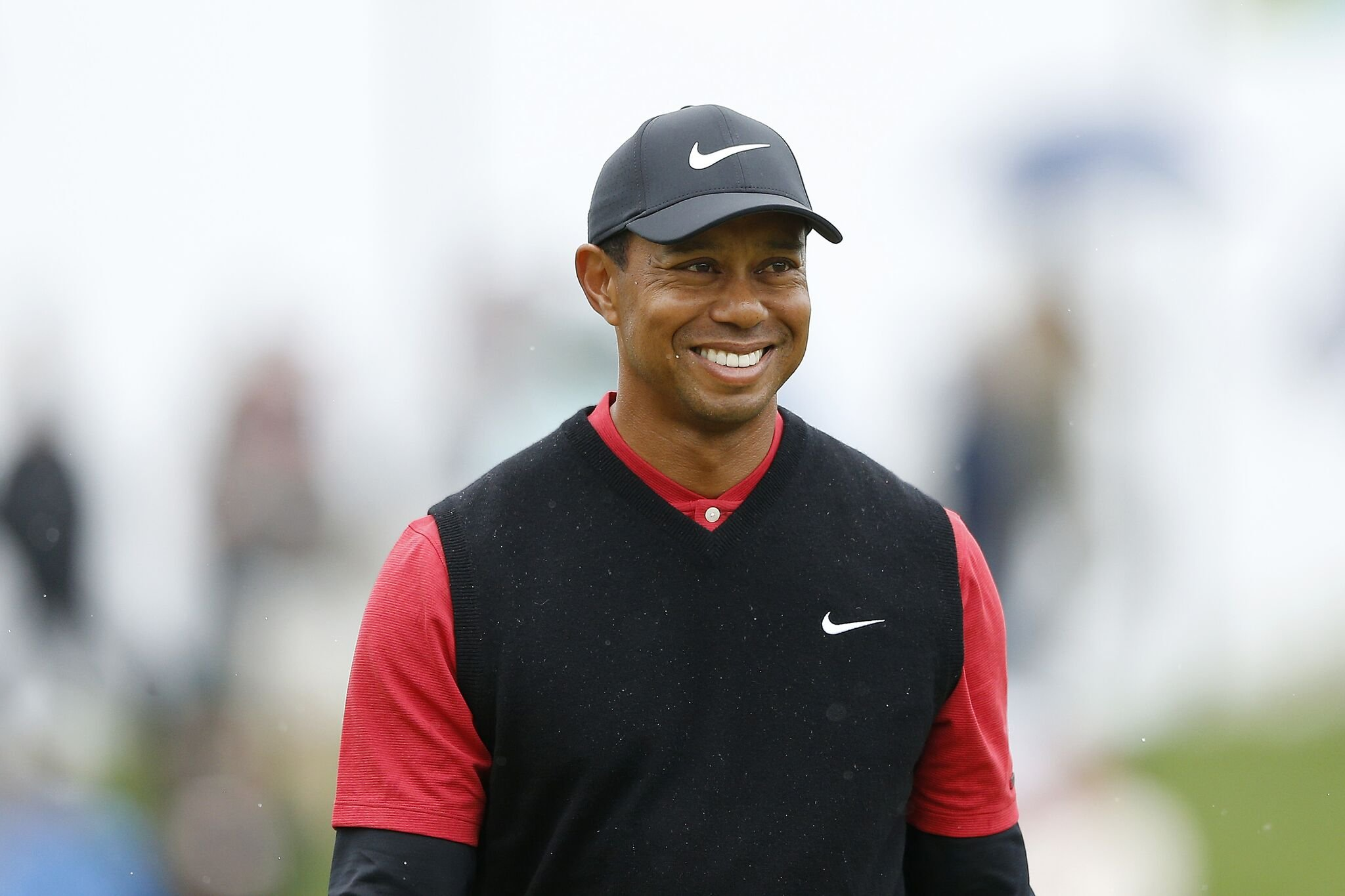 Tiger Woods of the United States reacts after chipping in from the bunker on the third hole during the final round of The PLAYERS Championship on The Stadium Course at TPC Sawgrass | Photo: Getty Images
