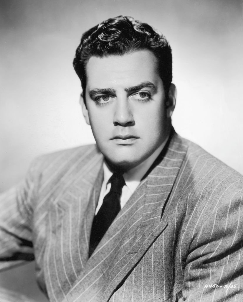 Raymond Burr wears a pinstriped suit in a promotional headshot for director Mitchell Leisen's film, 'Bride of Vengeance' | Photo: Getty Images