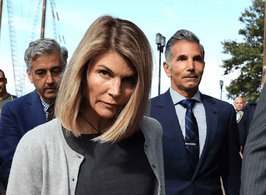 For the role in the national college admission scandal, Lori Loughlin and her husband, Mossimo Giannulli, leave the John Joseph Moakley United States Courthouse, on Aug. 27, 2019, Boston | Source: John Tlumacki/The Boston Globe via Getty Images