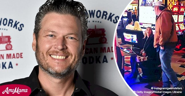 Blake Shelton startled fan by sneaking up on her as she played at his slot machine in Vegas