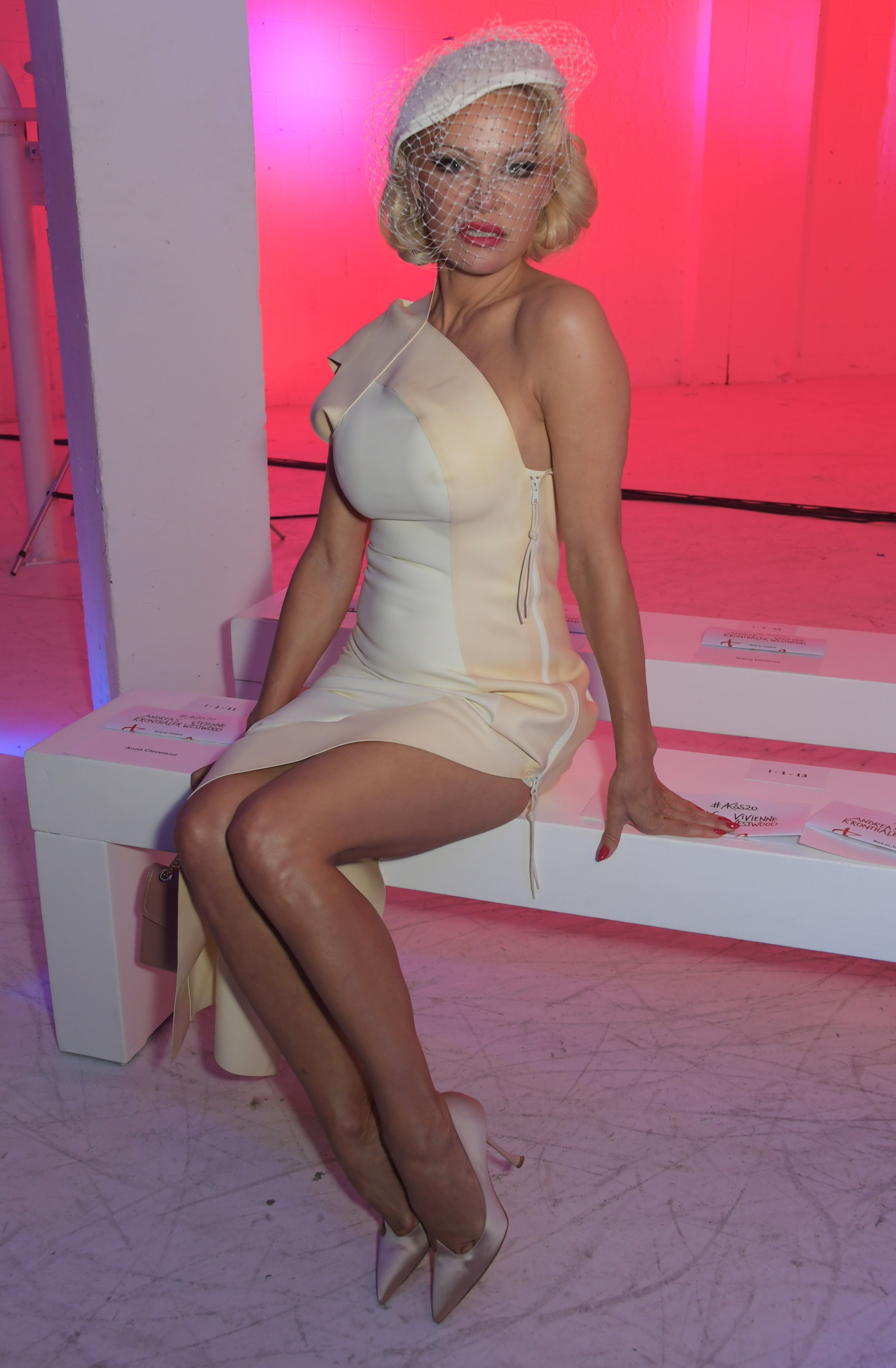 Pamela Anderson looks stunning in white at Paris Fashion Week, September, 2019 | Photo: Getty Images.