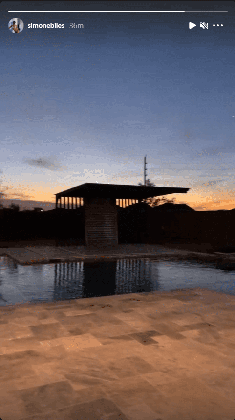 Screenshot of photo of sunset view of a swimming pool at Simone Biles' residence.| Source:  Instagram/simonebiles