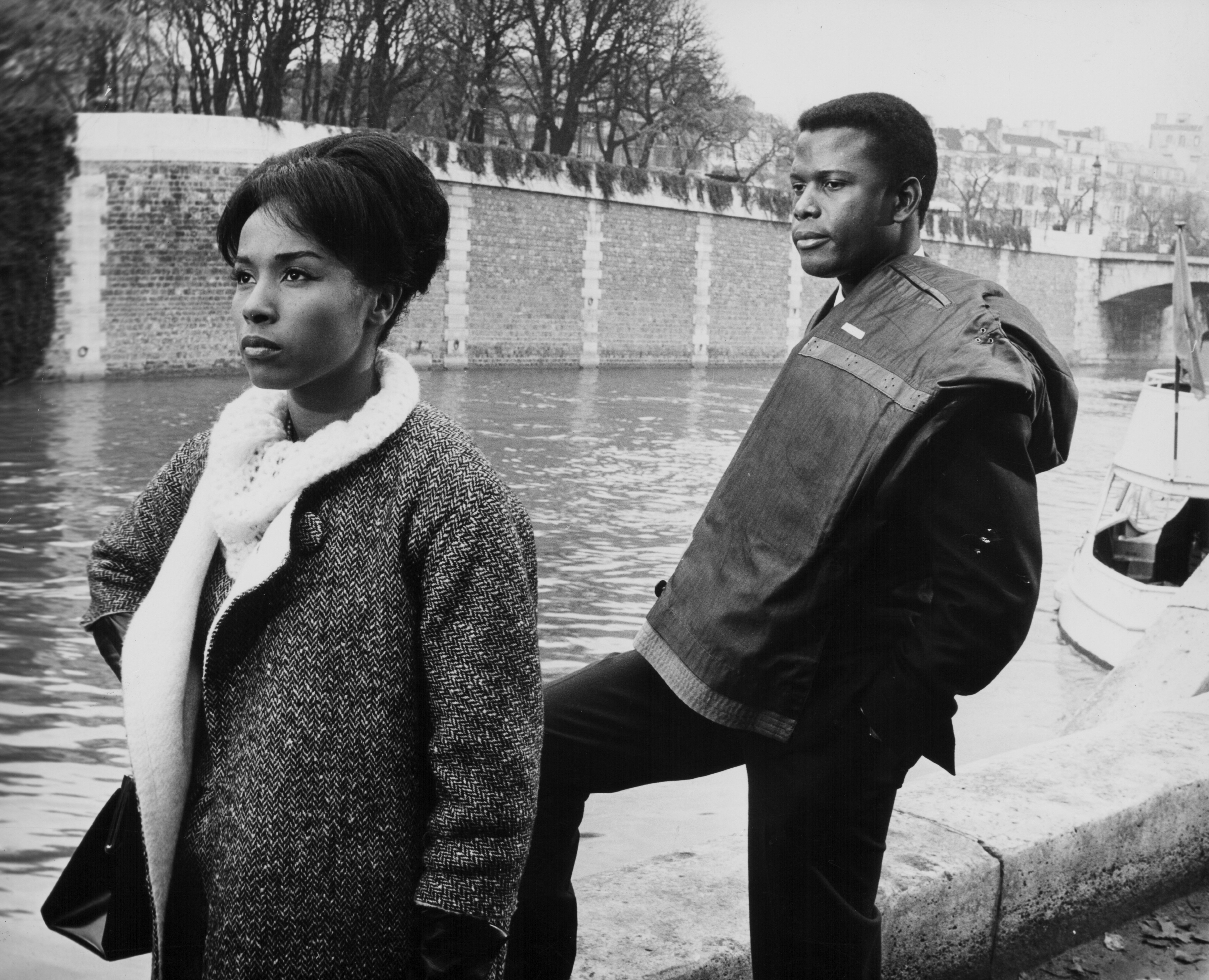 """Diahann Carroll and Sidney Poitier during a scene from the movie """"Paris Blues,"""" in 1961 