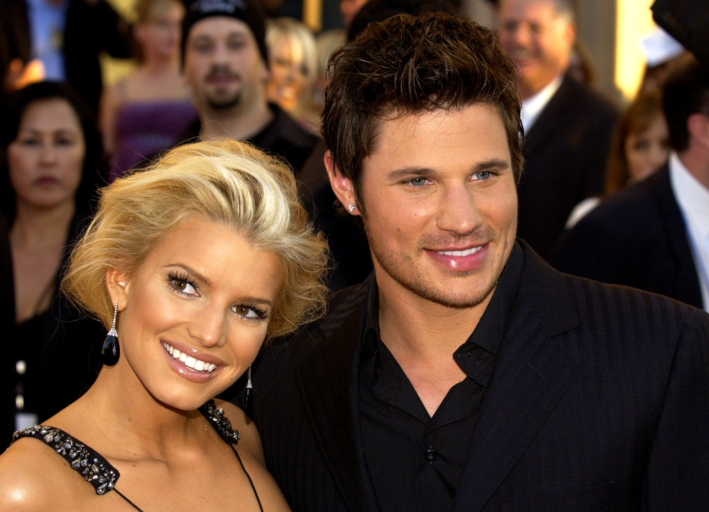 "Jessica Simpson (left) and husband Nick Lachey arrive at the 32nd Annual ""American Music Awards"" on November 14, 2004, at the Shrine Auditorium, in Los Angeles, California. 