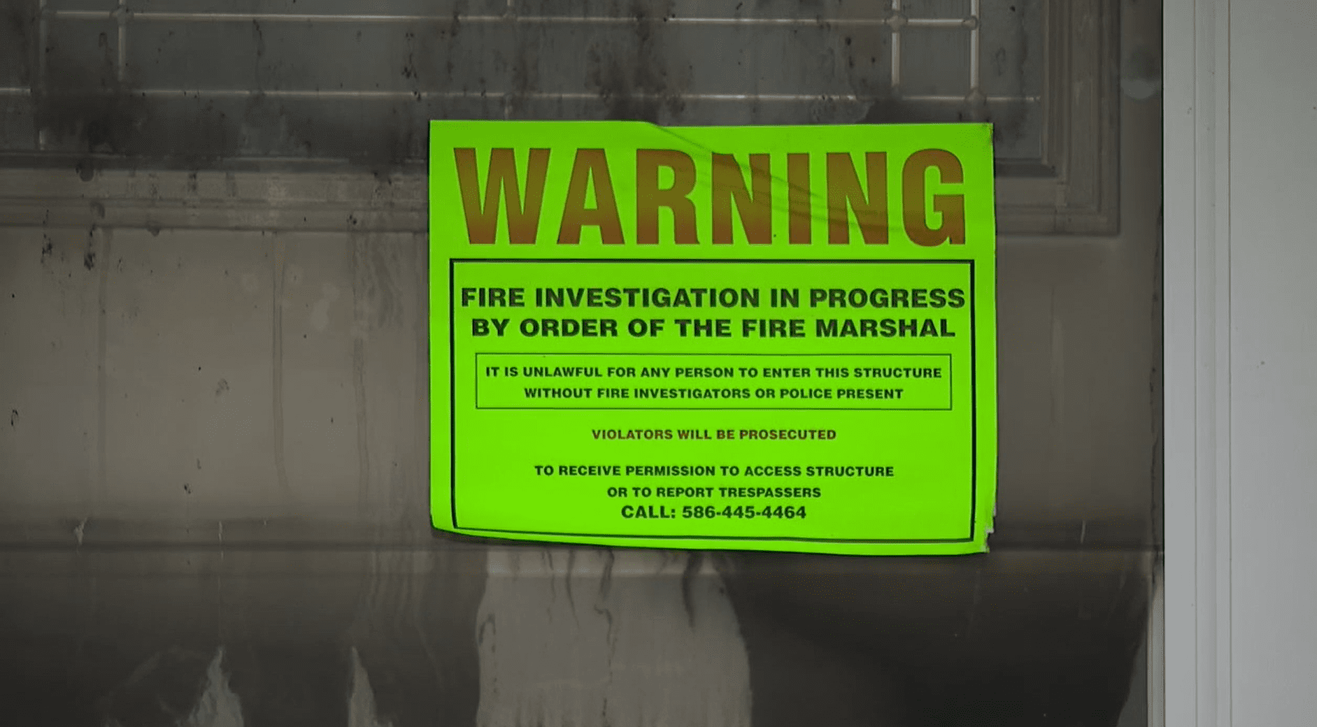 A warning and no entry sign stating that a house is under a fire investigation. │Source: Fox 2 Detroit