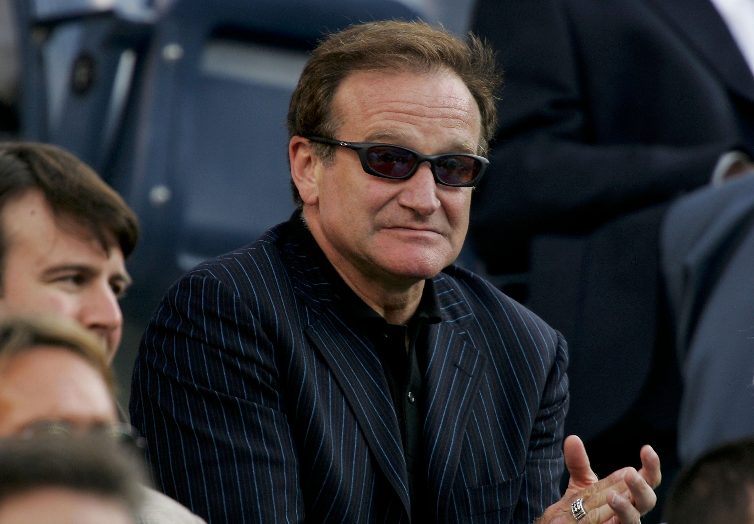 Actor Robin Williams cheers during the men's final, US Open 2005| Photo: Getty Images