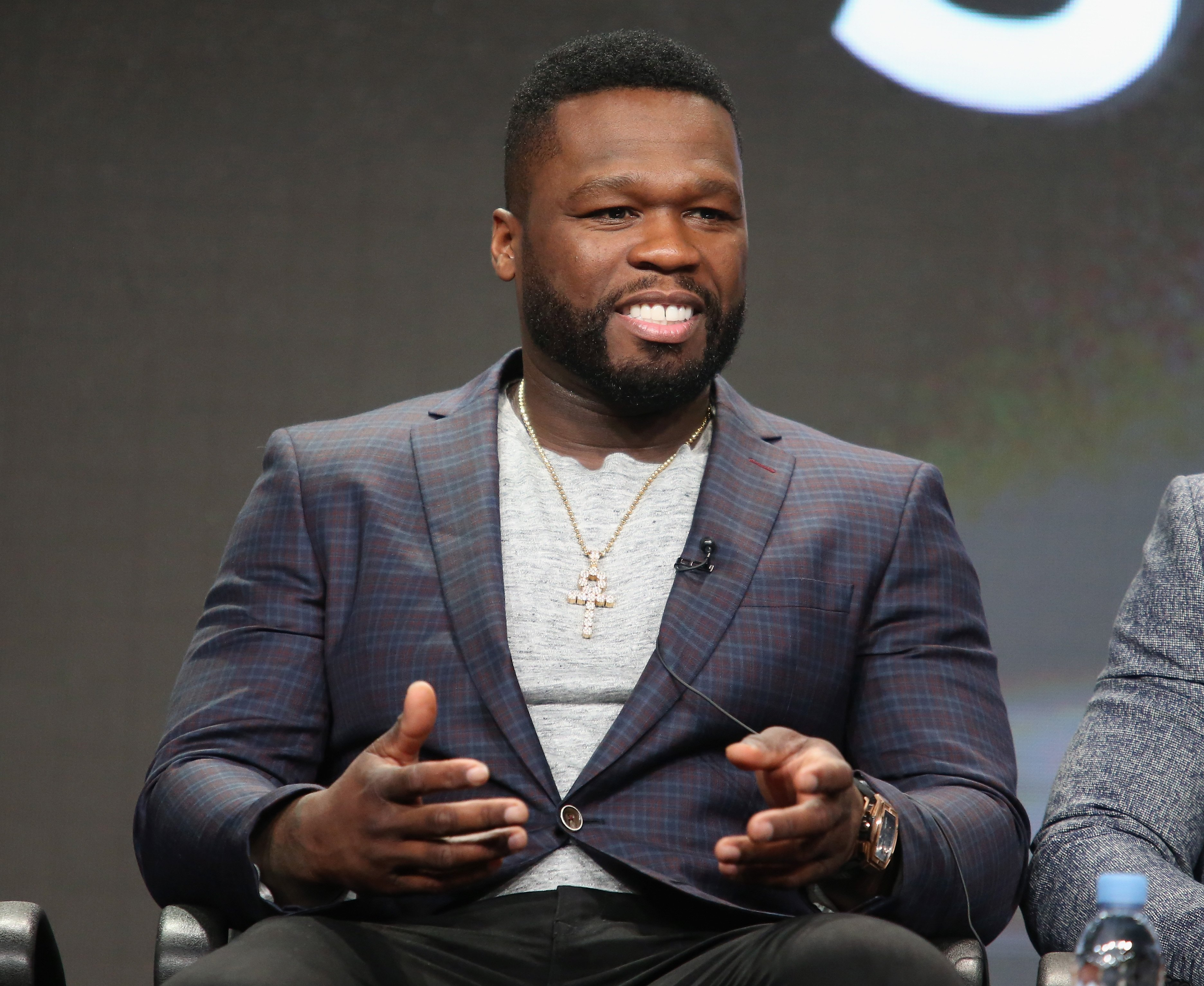 """50 Cent speaking at a """"Power"""" panel discussion in 2016. 