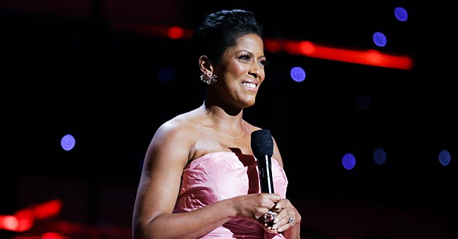 Tamron Hall's Baby Son Moses Calmly Sits on Her Lap as She Gives Him a Pedicure (Photo)