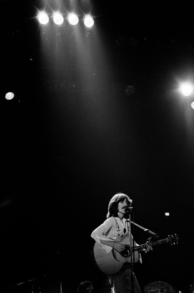 "Singer/songwriter and former Beatles member, George Harrison (R)performs on stage during his ""North American Tour"" at the Capitol Center 