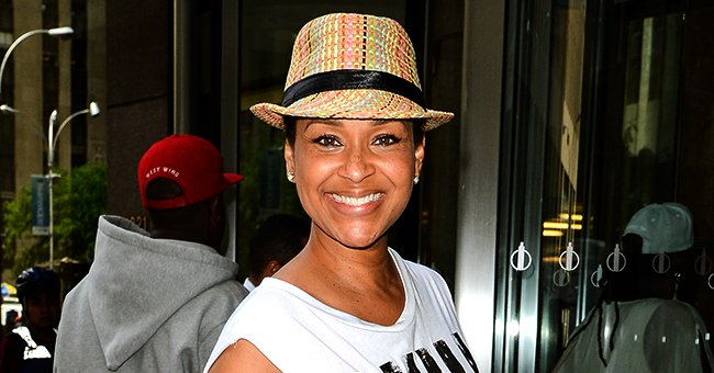 See LisaRaye McCoy's Youthful Glow in a New Instagram Update Featuring a Striped Suit & White Hat