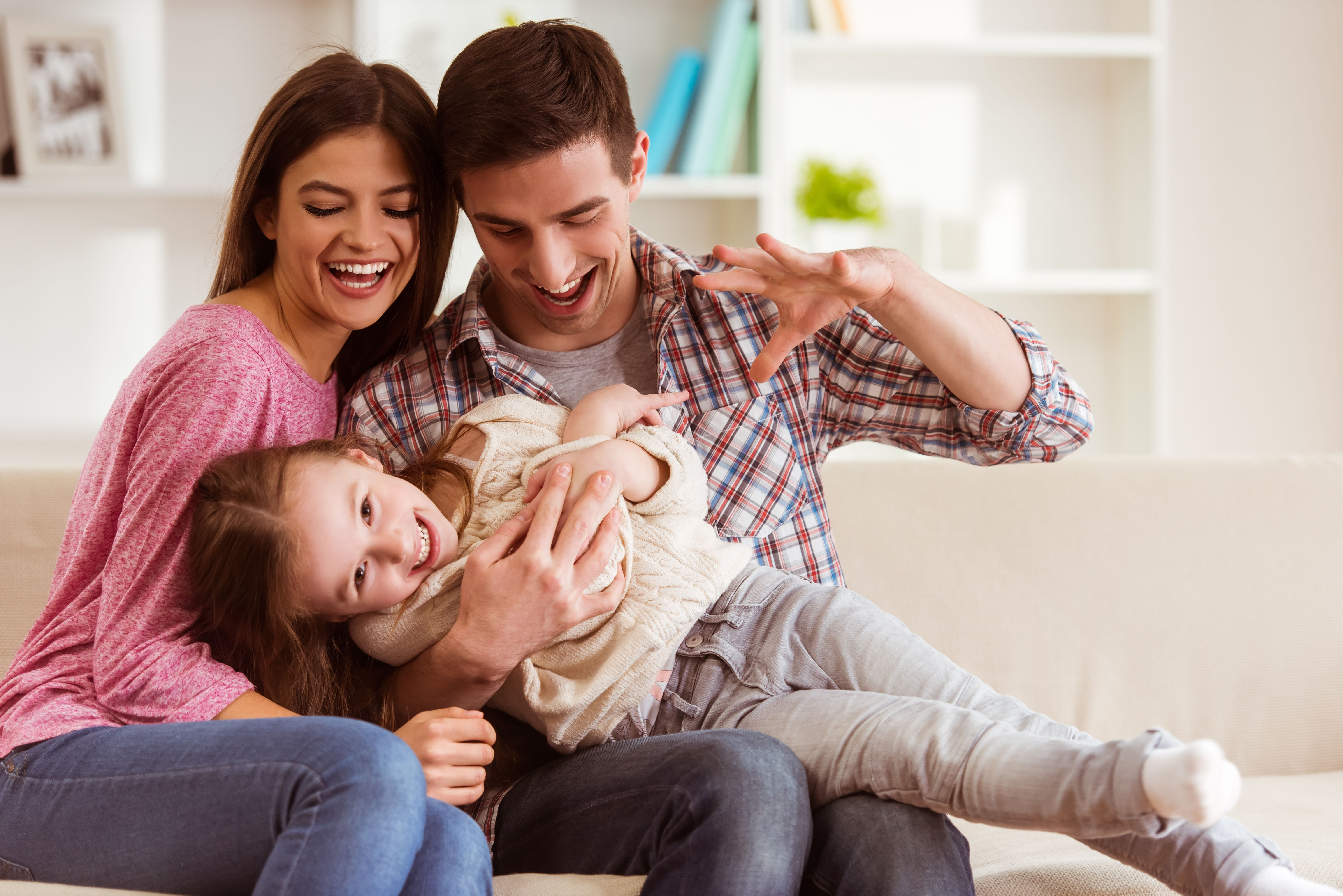 A little girl playing with her parents.   Source: Shutterstock