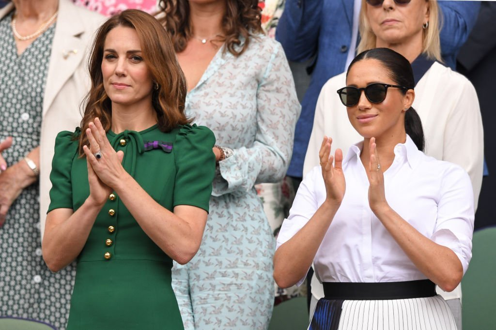 Kate Middleton and Meghan Markle in the Royal Box on Centre Court during day twelve of the Wimbledon Tennis Championships at All England Lawn Tennis and Croquet Club | Photo: Getty Images