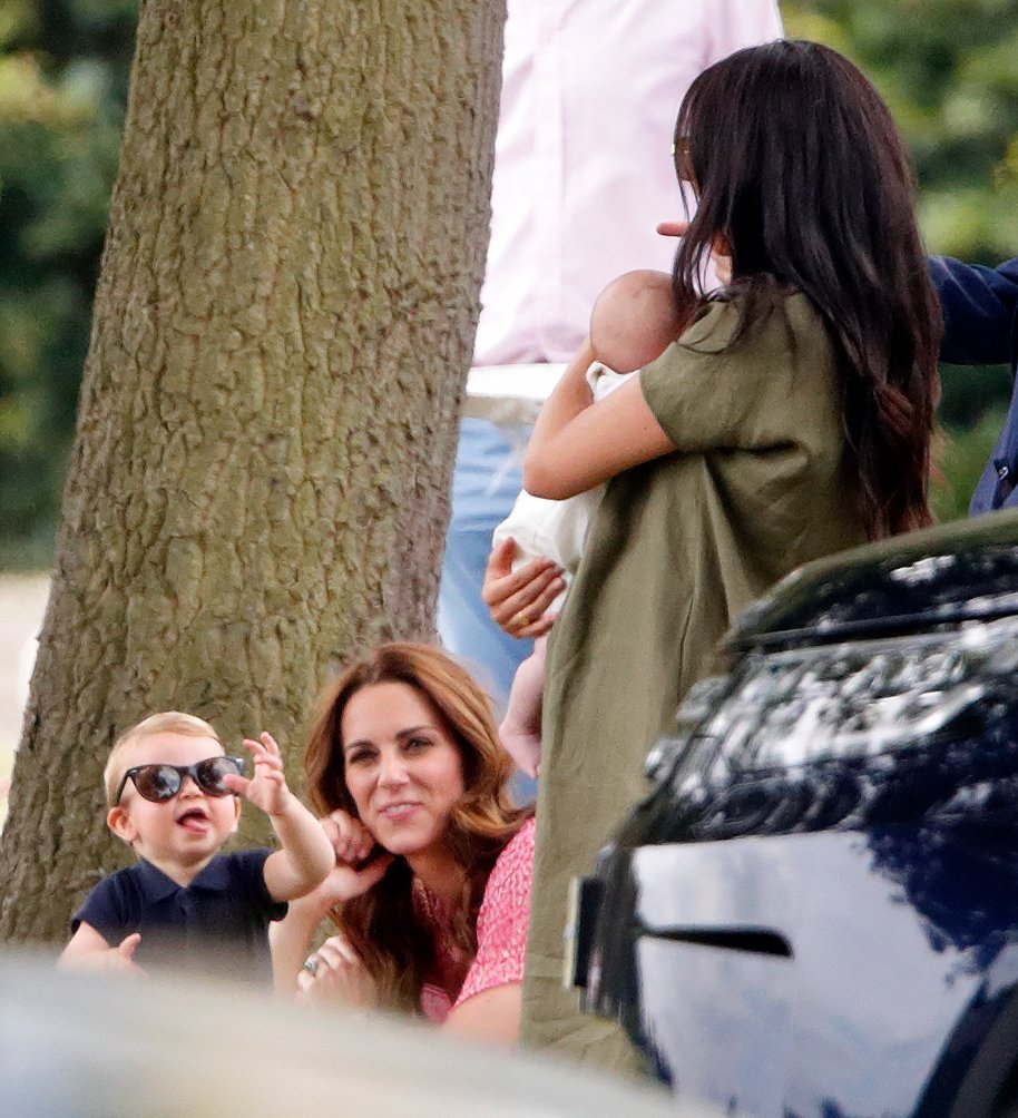 Prince Louis and Kate Middleton greet Meghan Markle and Archie Harrison at a charity polo match in July 2019 | Photo: Getty Images