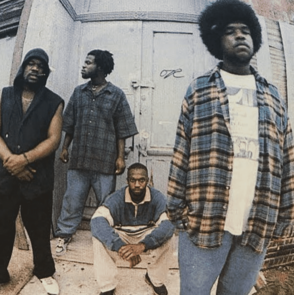 Members of The Roots, Questlove, Black Thought, and Malik B. stand outside a building | Source: instagram.com/questlove