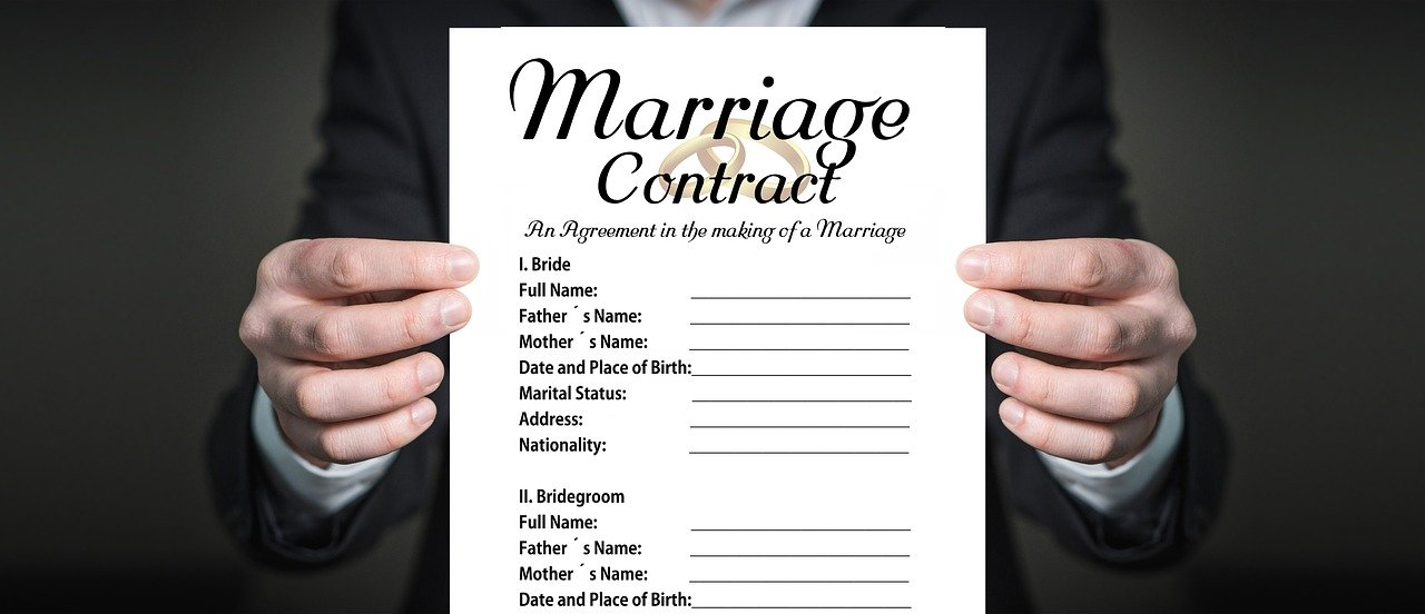 Closeup of a marriage contract. Image credit: Pixabay