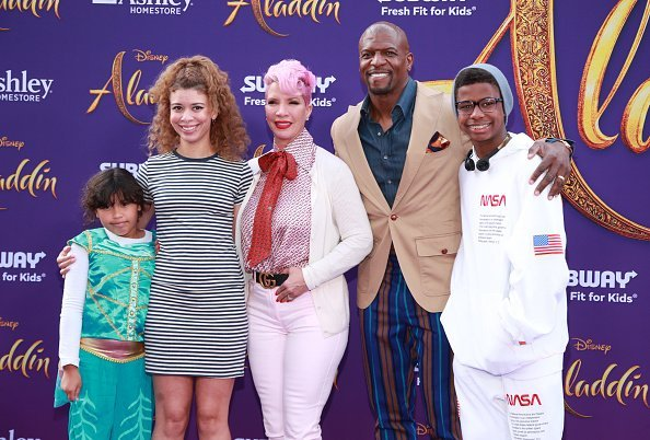 "Rebecca King-Crews and Terry Crews (C) and family attend the premiere of Disney's ""Aladdin"" on May 21, 2019, in Los Angeles, California. 