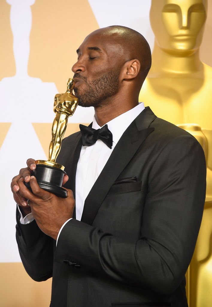 Kobe Bryant kisses his Oscar as he posed in the press room during the 90th Annual Academy Awards on March 4, 2018, in Hollywood, California | Source: Frazer Harrison/Getty Images