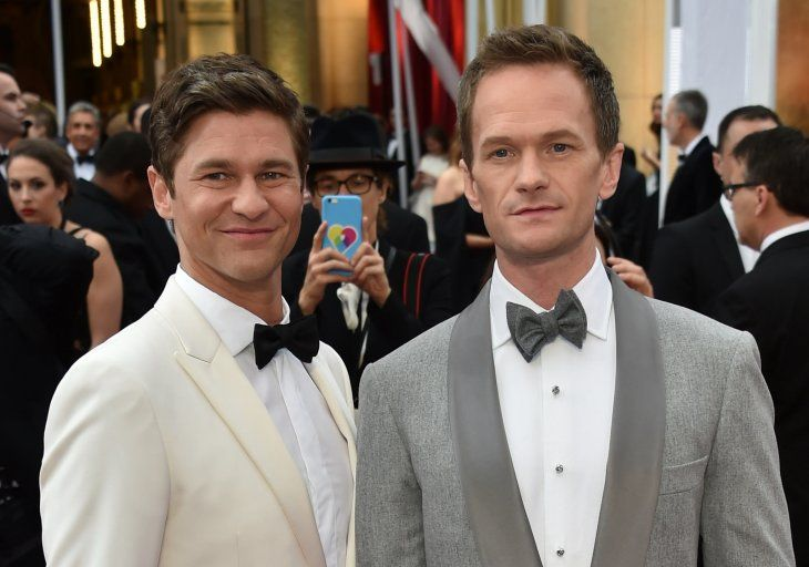 "Cookbook author David Burtka and husband Neil Patrick Harris at the launch of his book ""Life Is a Party"" in 2019 