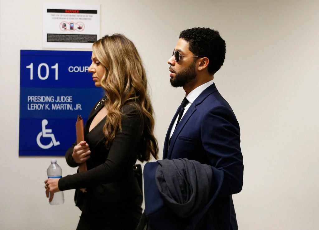 Jussie Smollett (R) and attorney Tina Glandian walk in Leighton Criminal Courthouse for his court appearance  in Chicago, Illinois | Photo: Getty Images