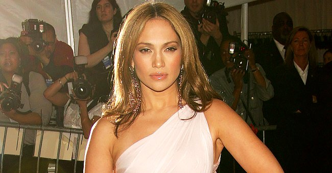Jennifer Lopez Rocks a Tiny Bra Top under a Stylish White Pant Suit — See Her Look Now