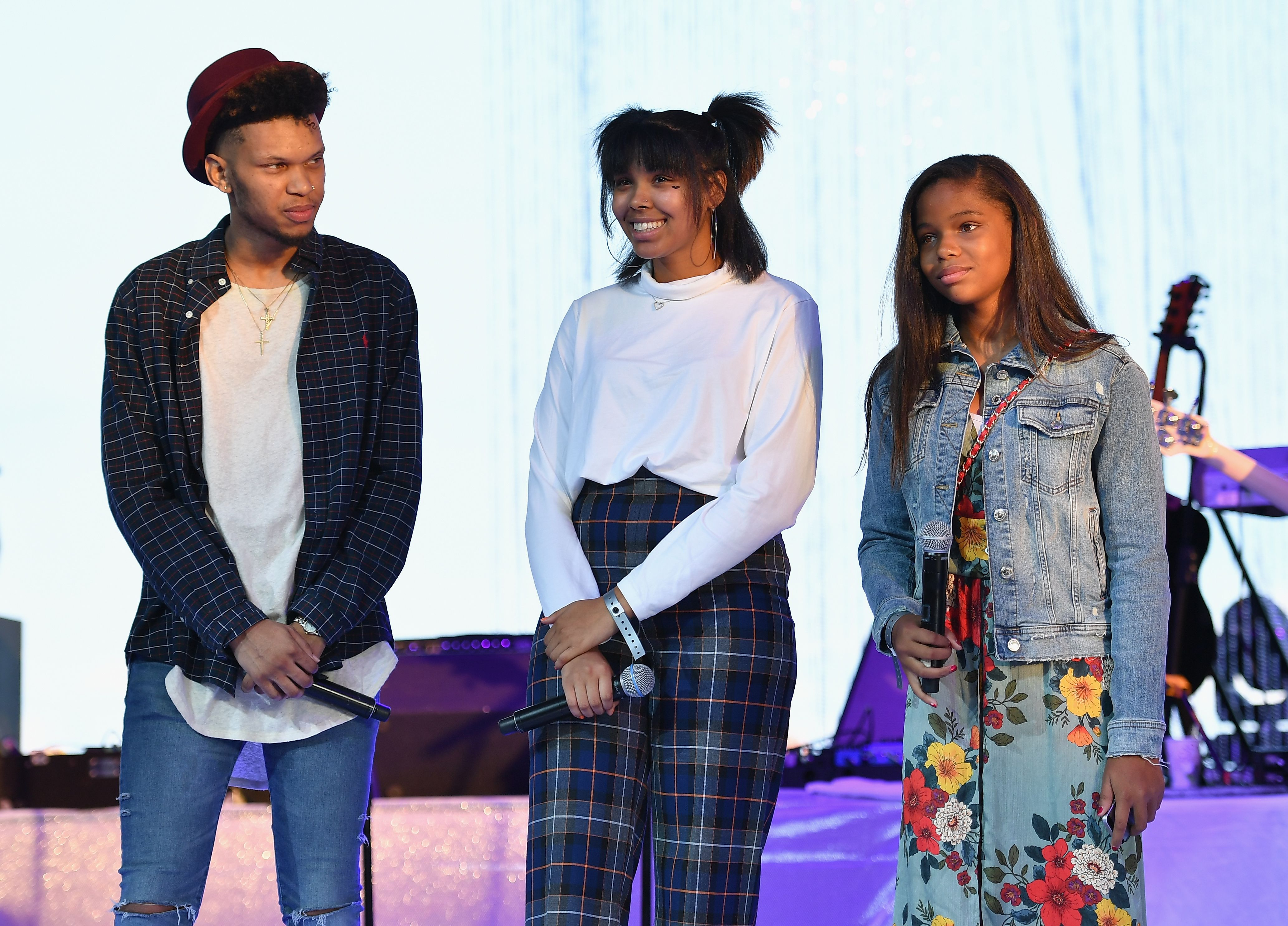 """Grandchildren of Aretha Franklin, Jonah, Victorie and Gracie on stage at the """"A People's Tribute to the Queen"""" event on August 30, 2018 in Detroit, Michigan 