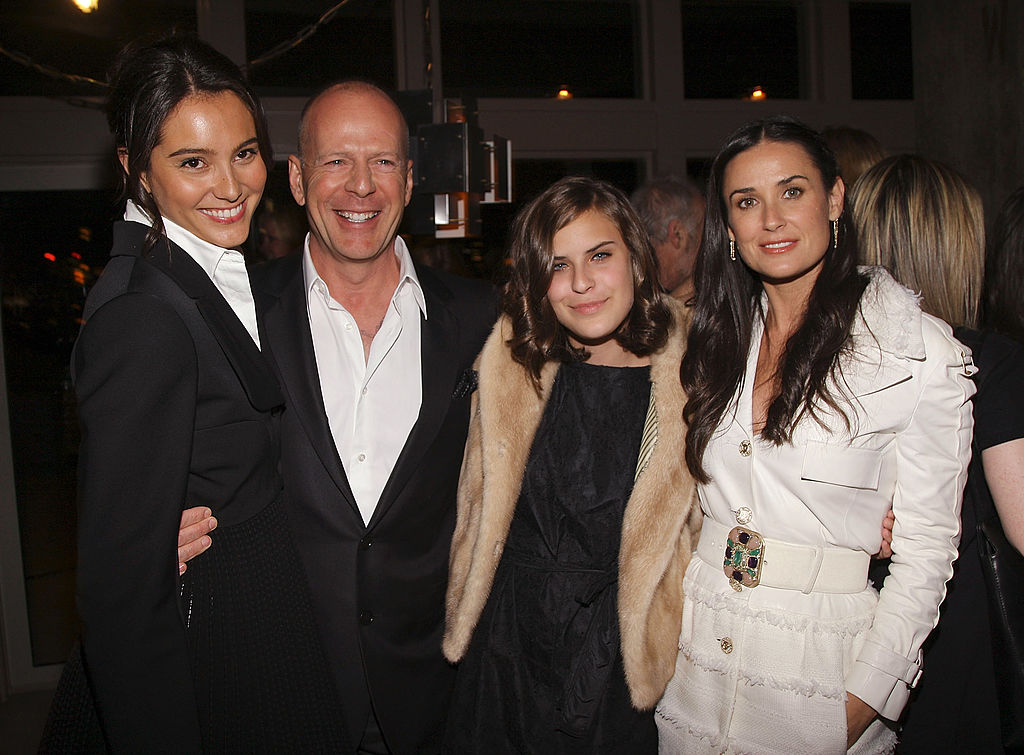 Image Credits: Getty Images/ Actress Emma Hemming, actor Bruce Willis, his daughter Tallulah Belle Willis, and her mother actress Demi Moore