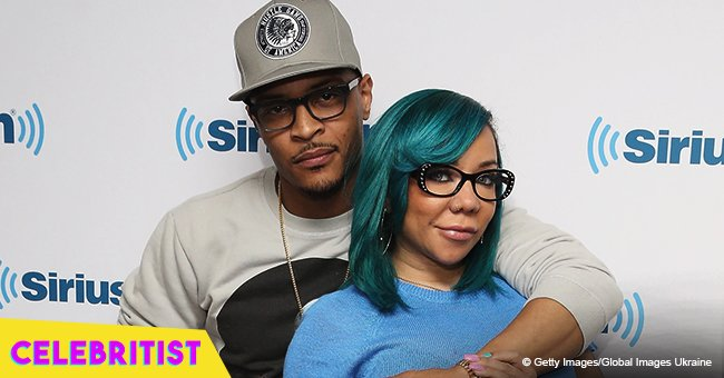 T.I. slammed after being caught on camera with another woman