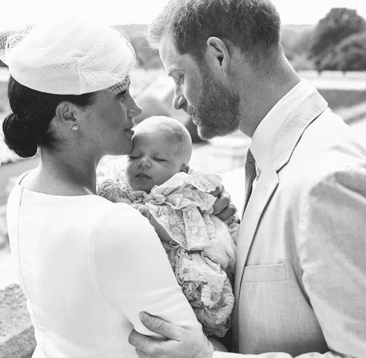 Meghan and Harry embrace their first-born son Archie on the day of his christening. | Source: Instagram/SusseRoyal