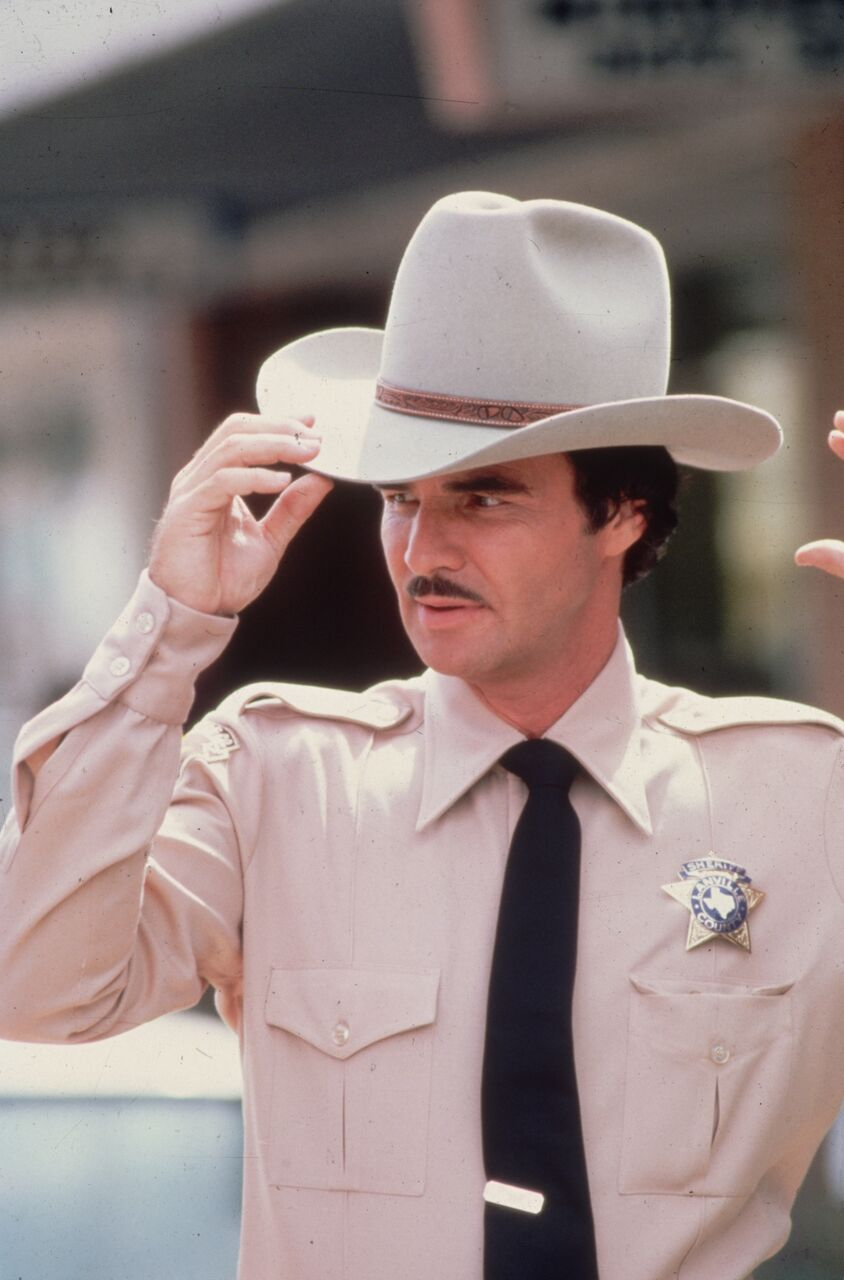 Film star Burt Reynolds as a sheriff. | Source: Getty Images
