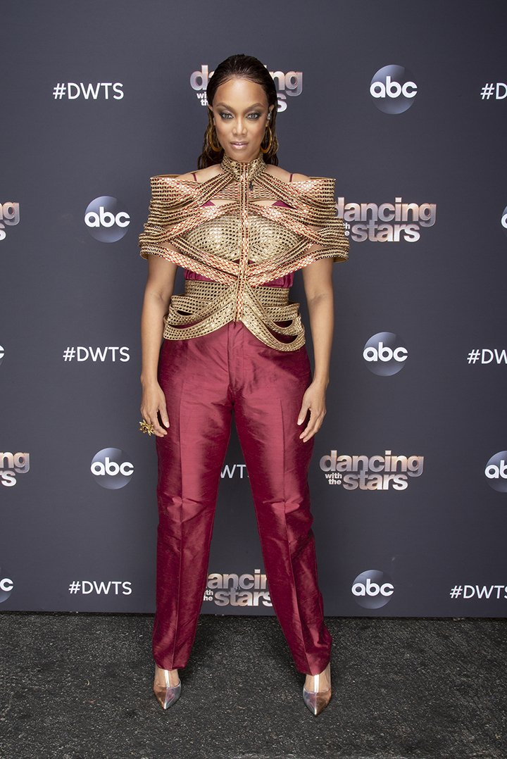 """Tyra Banks posing with her outfit as a host of the TV series """"Dancing with the Stars"""" for its October 19, 2020, episode. I Image: Getty Images."""