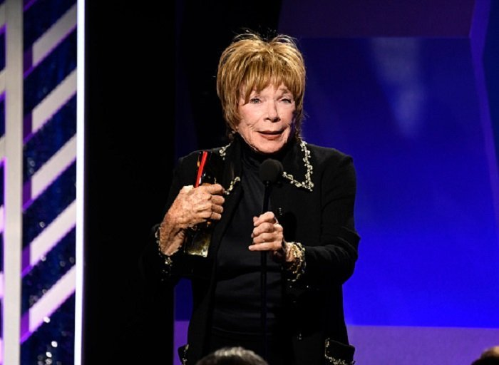Shirley MacLaine speaks onstage at the 18th Annual AARP The Magazine's Movies For Grownups Awards at the Beverly Wilshire Four Seasons Hotel on February 04, 2019 in Beverly Hills, California   Photo: Getty Images