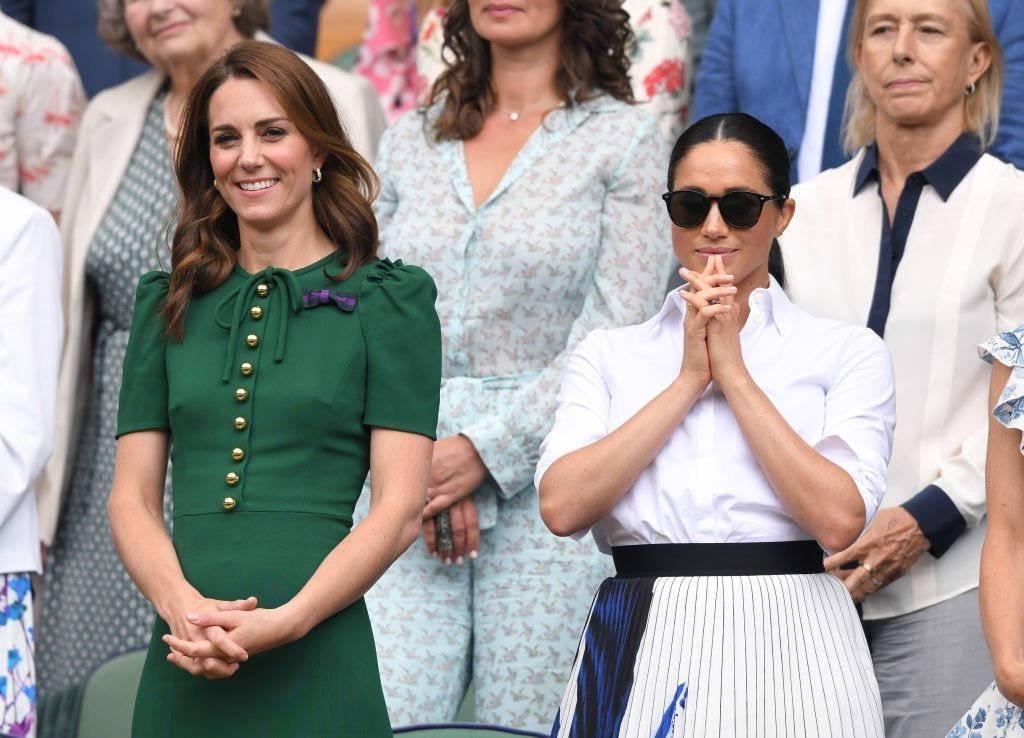 Catherine, Duchess of Cambridge and Meghan, Duchess of Sussex in the Royal Box on Centre Court during day twelve of the Wimbledon Tennis Championships. | Photo: Getty Images