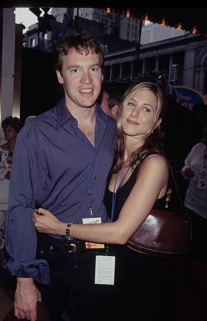 """Jennifer Aniston and Tate Donovan share an embrace at an event for the movie """"Hercules""""onJanuary 01, 1998