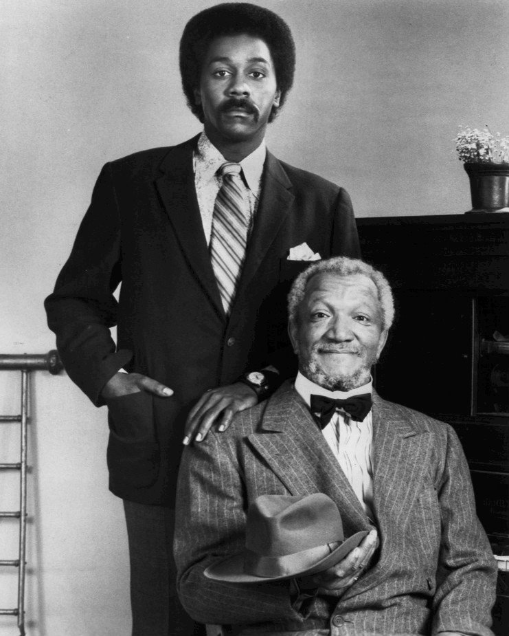 "Redd Foxx as Fred Sanford and Demond Wilson as his son, Lamont in the TV program ""Sandford and Son."" 