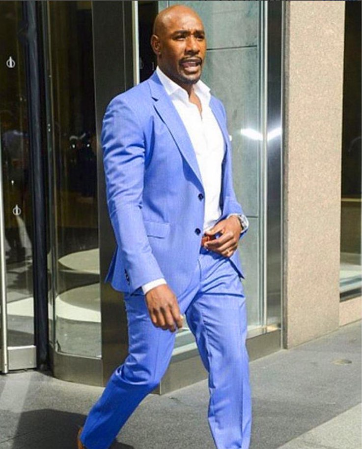 Source: Instagram / Morris Chestnut / Morris Chestnut walks out of a building in a blue suit and white shirt