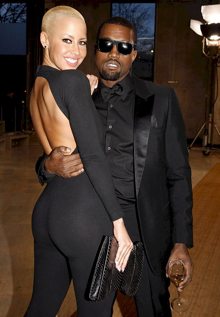 PARIS - MARCH 09: Amber Rose and Kanye West attend the Yves Saint Laurent Ready-to-Wear A/W 2009 fashion show during Paris Fashion Week at Palais de Tokyo on March 9, 2009 in Paris, France. (Photo by Michel Dufour/WireImage)