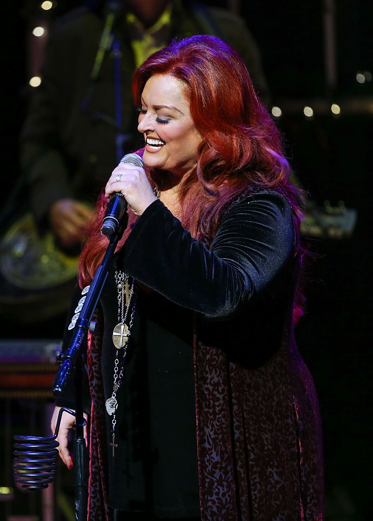 "Wynonna Judd performs during ""A Wynonna & The Big Noise Christmas"" at CMA Theater at the Country Music Hall of Fame and Museum on December 14, 2016 in Nashville, Tennessee. 