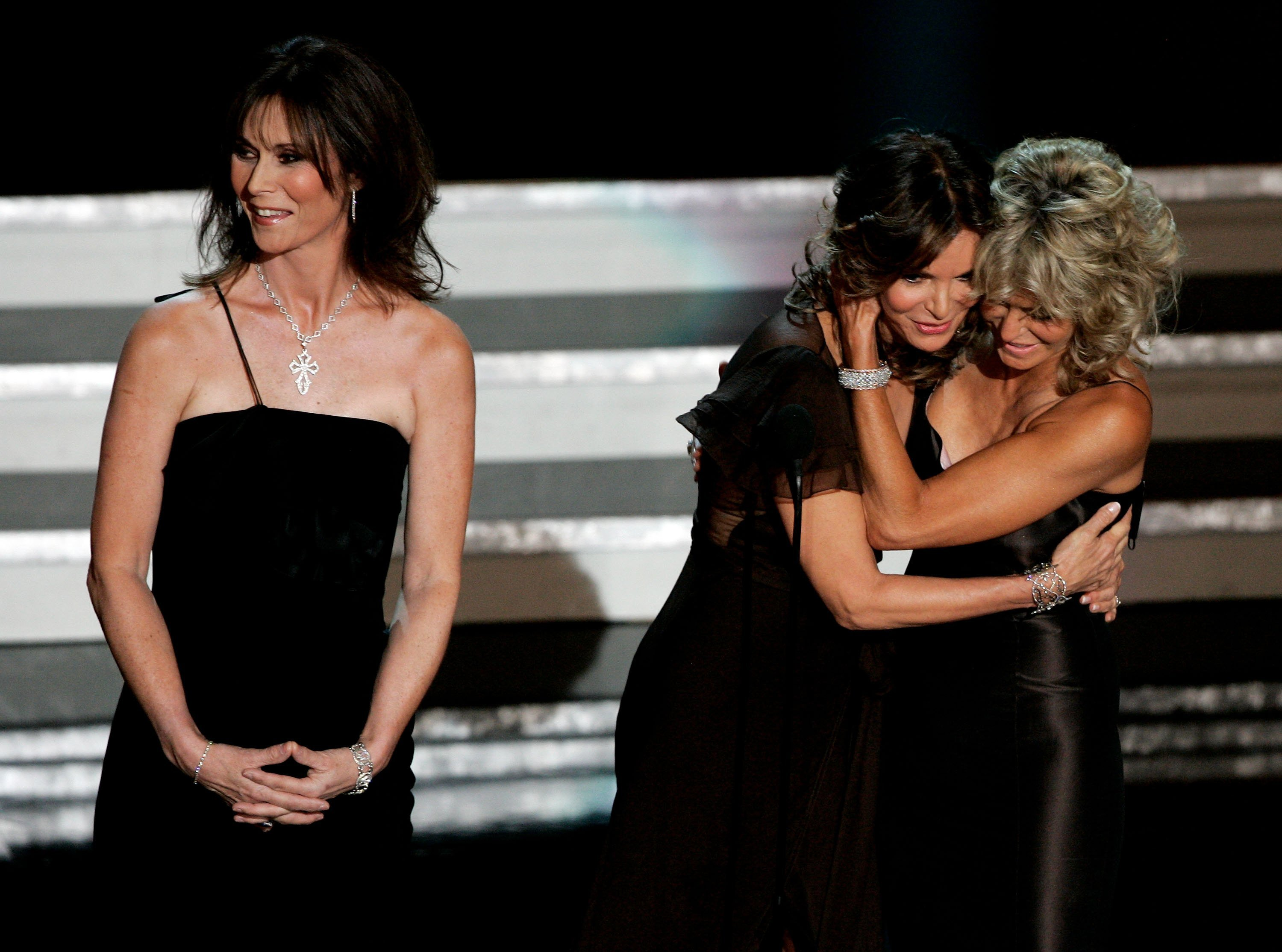 Actresses Kate Jackson, Jaclyn Smith, and Farrah Fawcett present onstage at the 58th Annual Primetime Emmy Awards. | Source: Getty Images