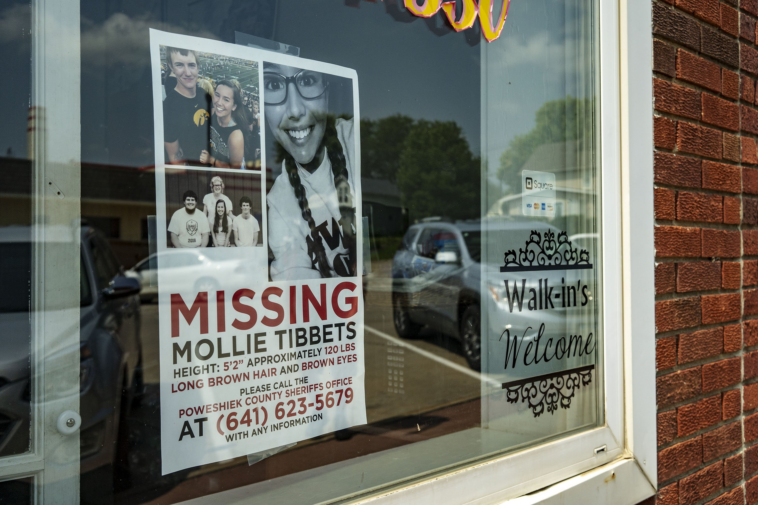 A poster offering a reward for any information regarding the whereabouts of Mollie Tibbetts on a window in Brooklyn, Iowa   Photo: KC McGinnis/For The Washington Post via Getty Images