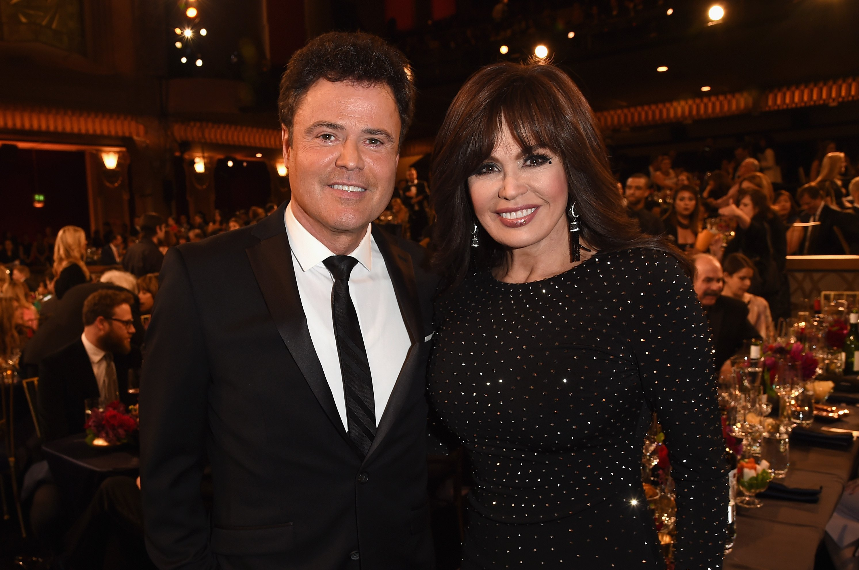 Sibling superstars Donny and Marie Osmond during a 2015 awards ceremony in Beverly Hills. | Photo: Getty Images