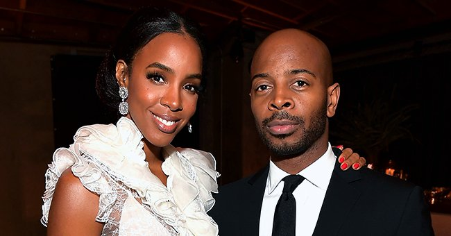 Kelly Rowland Flaunts Baby Bump in a Stunning Green Dress While Posing with Her Husband & Son