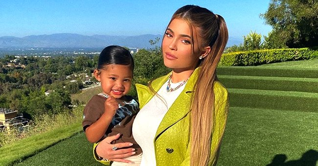 Check Out Kylie Jenner's Daughter Stormi Sitting Outdoors in Her Cool White Outfit and Hair Bun