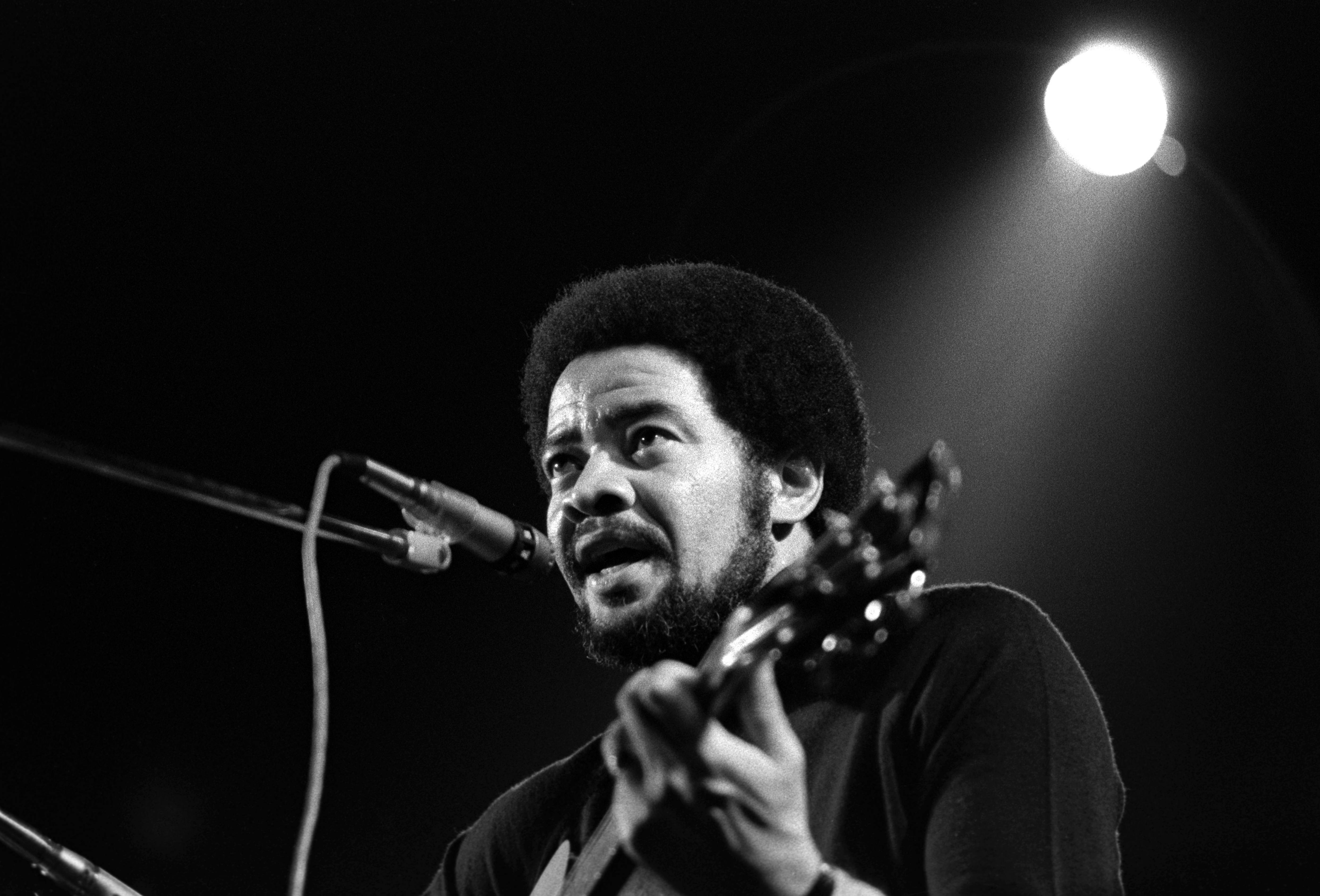 Bill Withers performs onstage at the Rainbow Theatre on October 1, 1973 in United Kingdom.   Photo: Getty Images