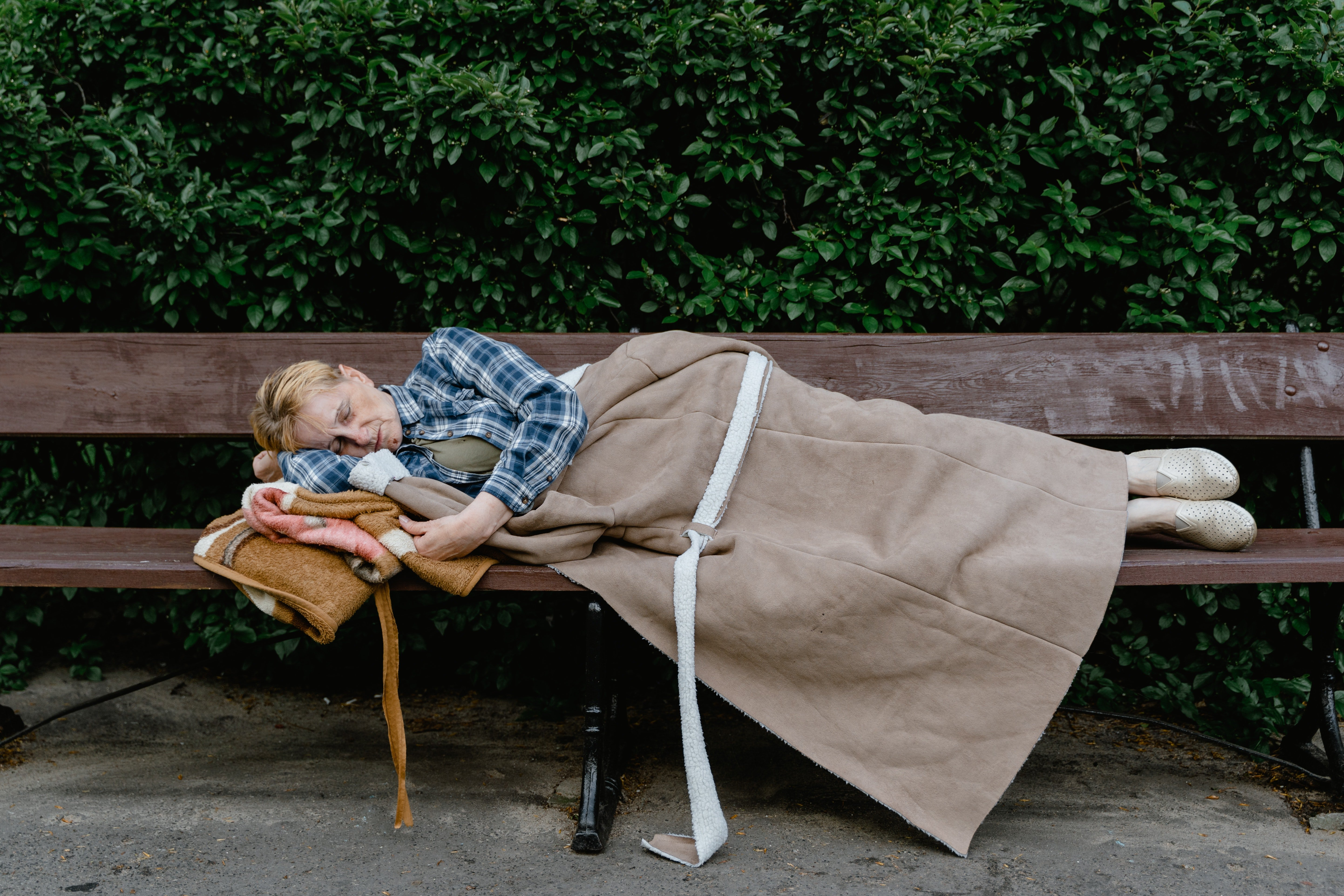 I saw a man sleeping on a bench and I recognized him.   Source: Pexel