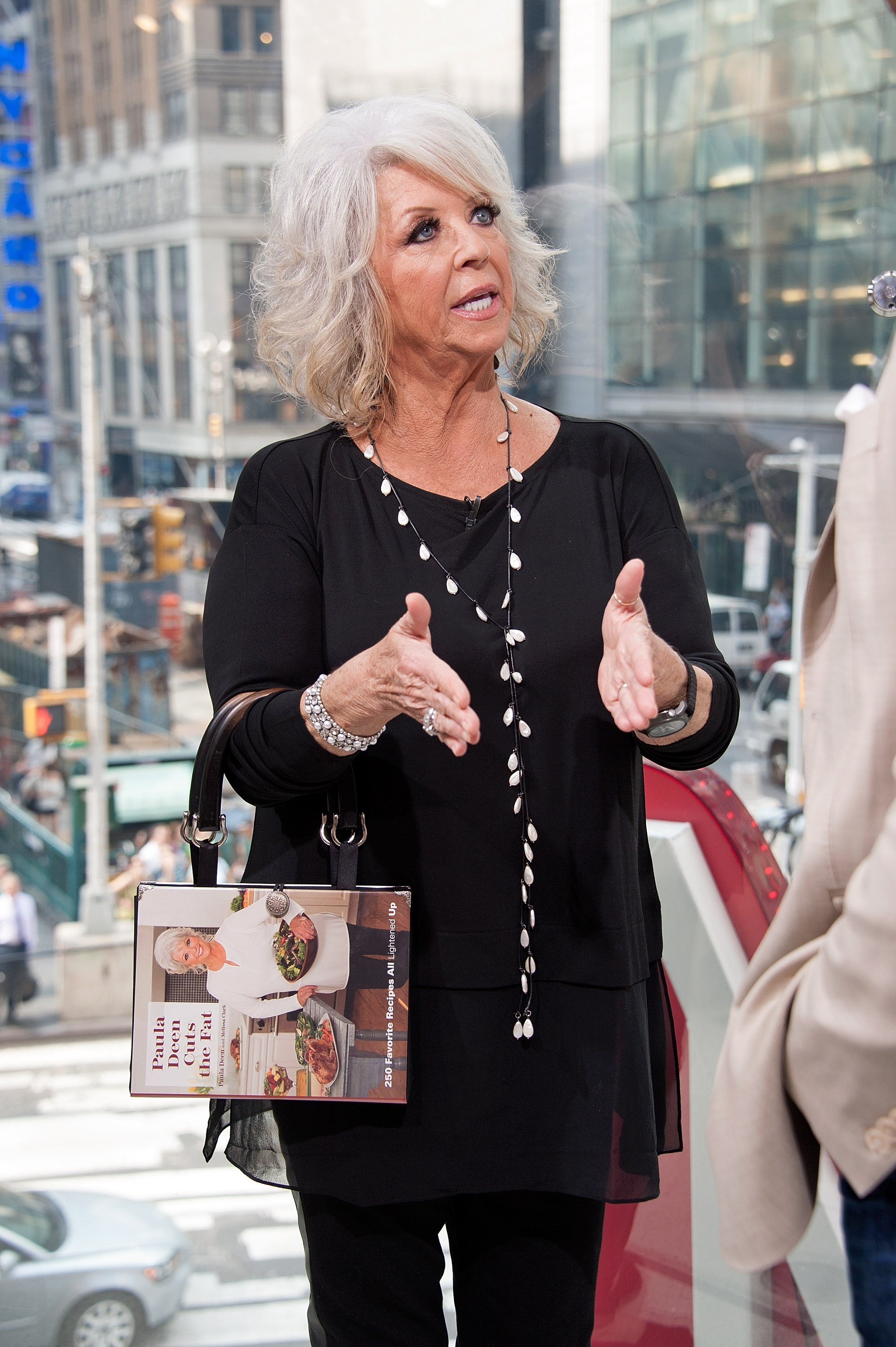 Paula Deen visits 'Extra' at their New York studios at H&M in Times Square on September 2, 2015 in New York City | Photo: Getty Images