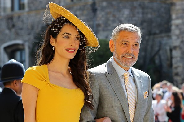 Amal Clooney and George Clooney at Windsor Castle before the wedding of Prince Harry to Meghan Markle on May 19, 2018 in Windsor, England. | Photo: Getty Images